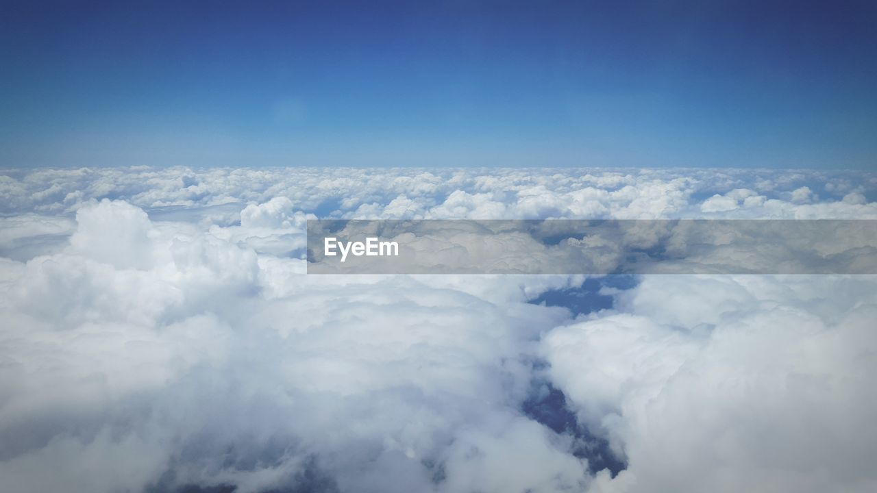 cloud - sky, nature, sky, beauty in nature, scenics, tranquility, cloudscape, blue, white color, outdoors, tranquil scene, day, no people, sky only, aerial view, backgrounds, the natural world
