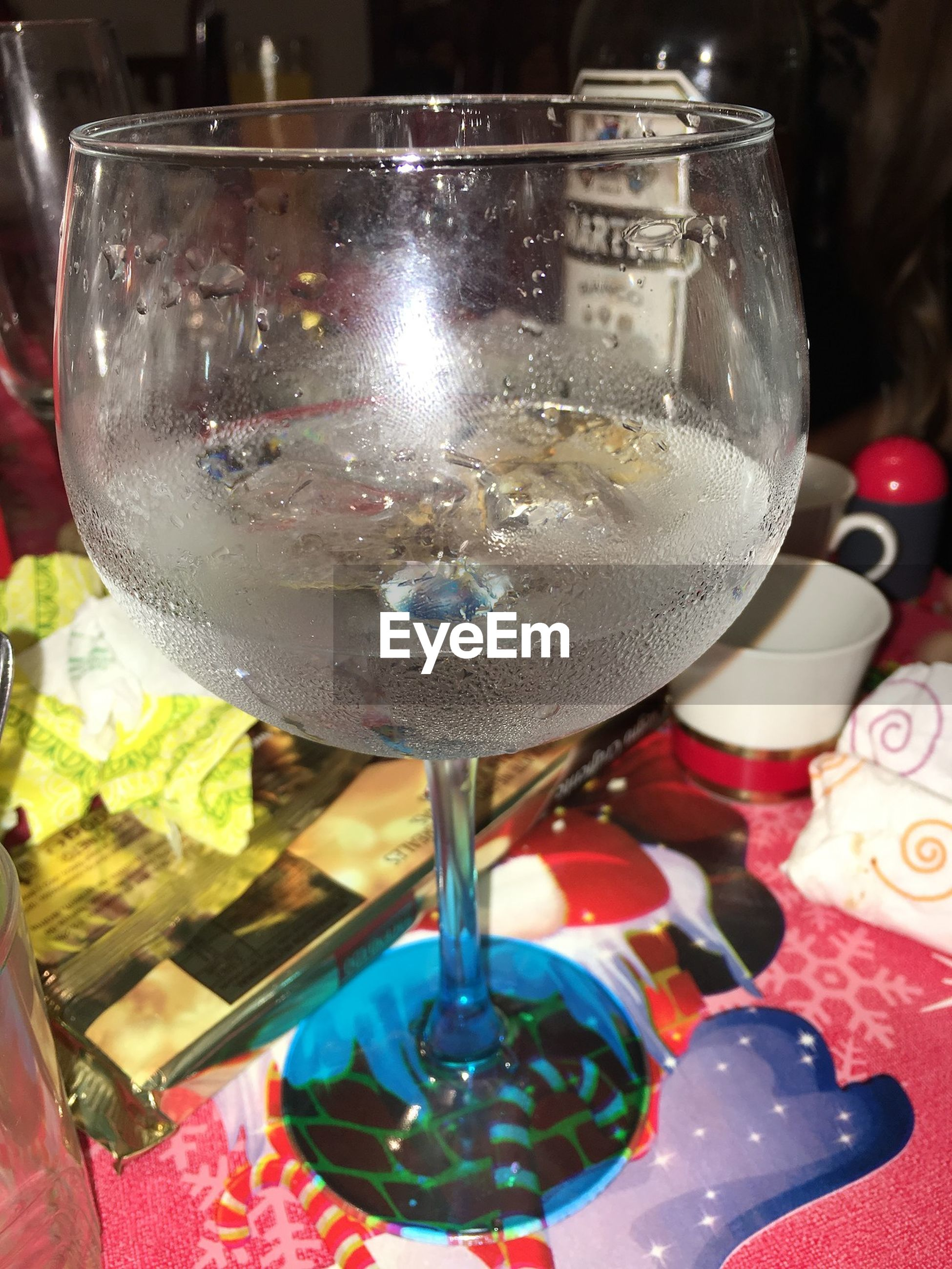 indoors, drink, food and drink, still life, table, drinking glass, glass - material, close-up, refreshment, freshness, alcohol, transparent, high angle view, no people, wineglass, restaurant, glass, bottle, wine, focus on foreground