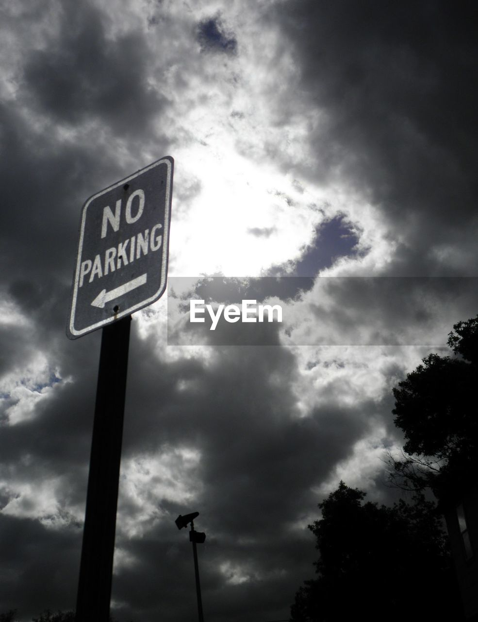 low angle view, communication, cloud - sky, sky, text, road sign, no people, day, guidance, outdoors, nature
