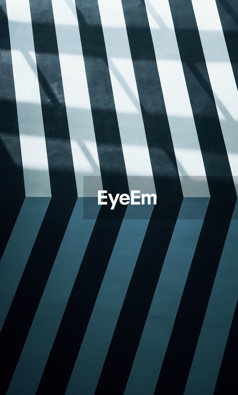 pattern, backgrounds, no people, full frame, indoors, geometric shape, design, striped, shape, black color, reflection, close-up, architecture, wall - building feature, glass - material, sky, repetition, nature