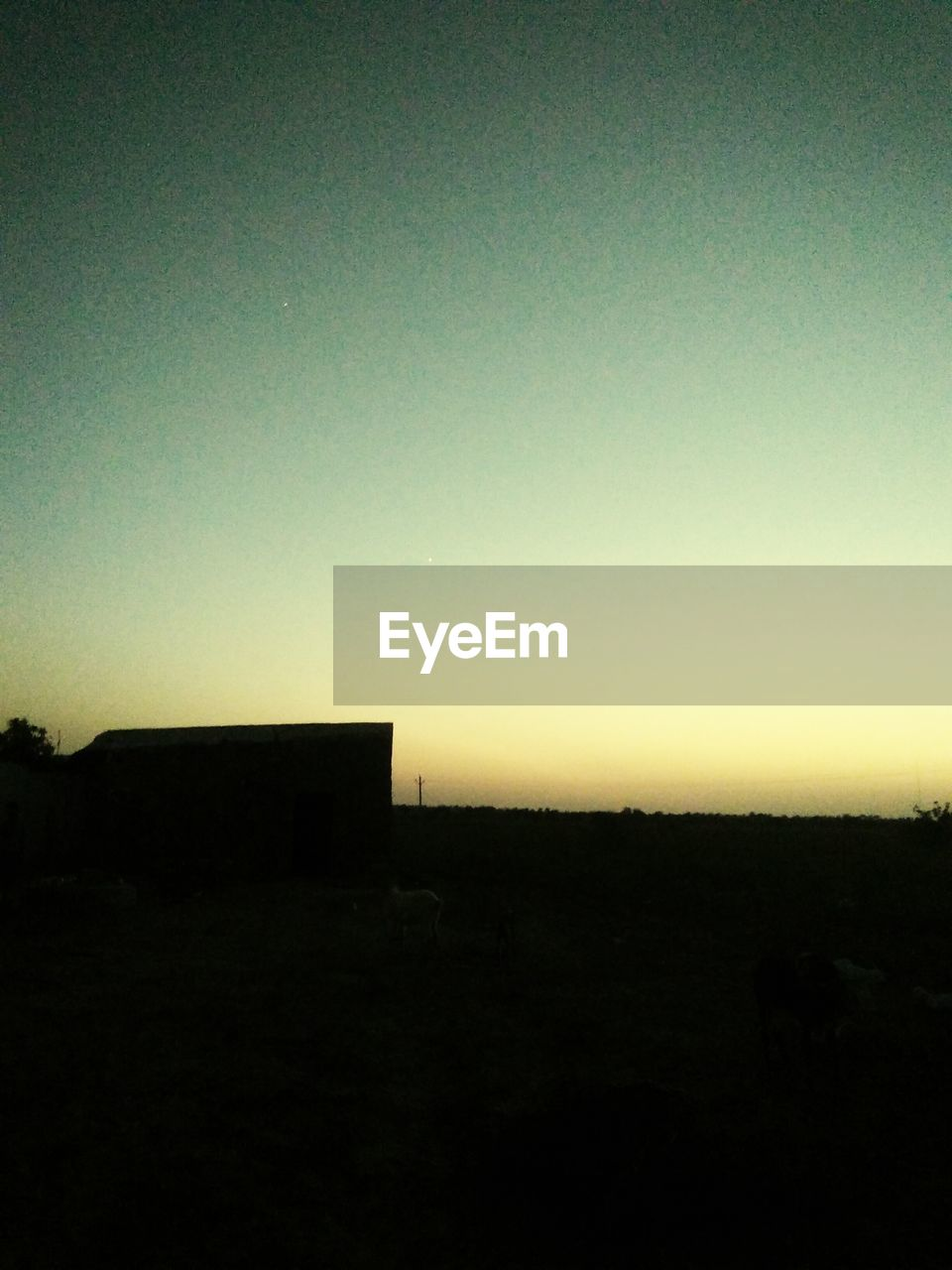 sky, silhouette, environment, copy space, sunset, landscape, scenics - nature, nature, clear sky, tranquil scene, tranquility, no people, beauty in nature, field, land, outdoors, architecture, dark, horizon over land, horizon