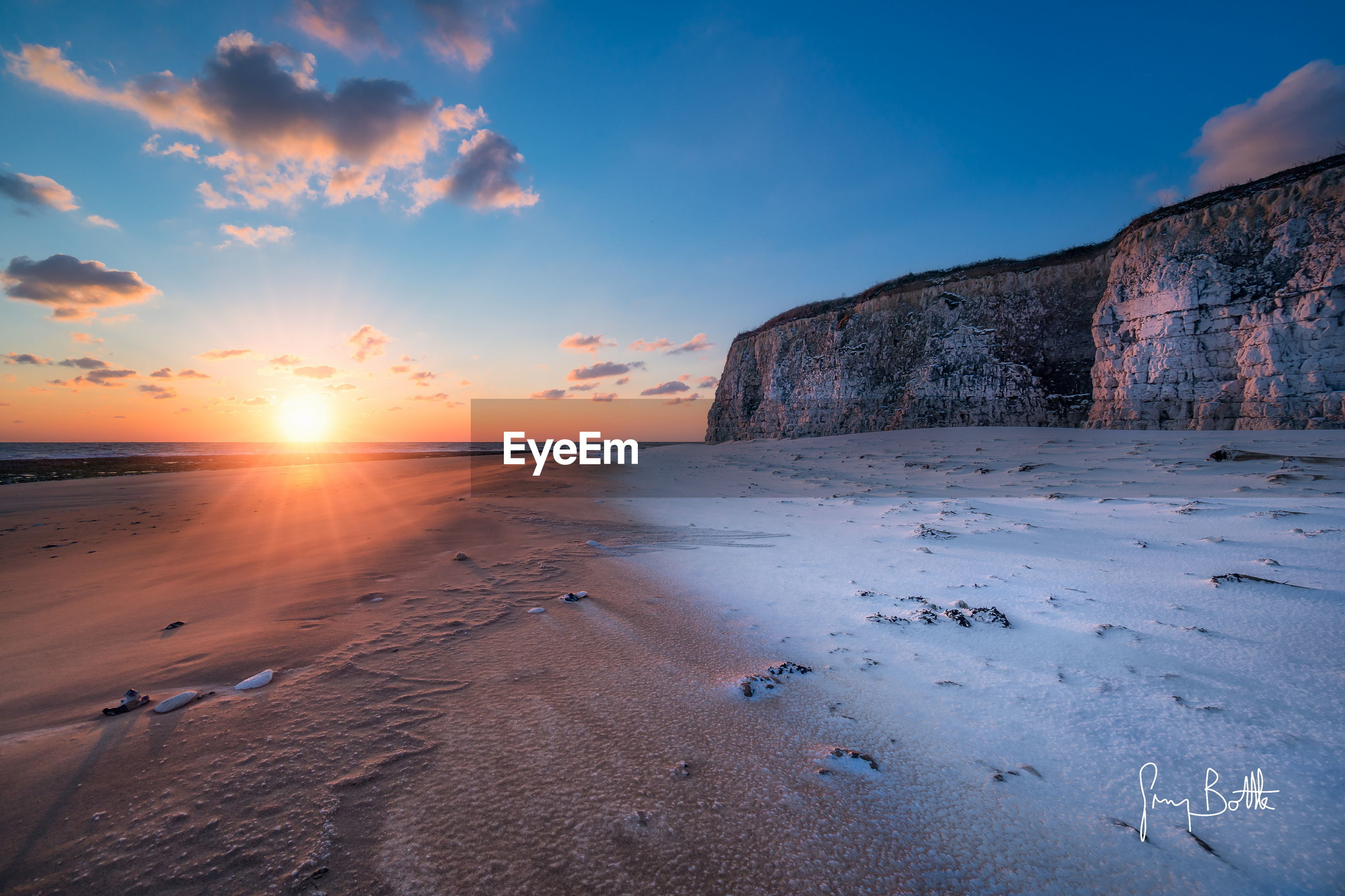 sunset, sky, nature, scenics, sun, beauty in nature, sea, beach, tranquility, tranquil scene, sand, outdoors, sunlight, water, rock - object, cloud - sky, no people, horizon over water, day