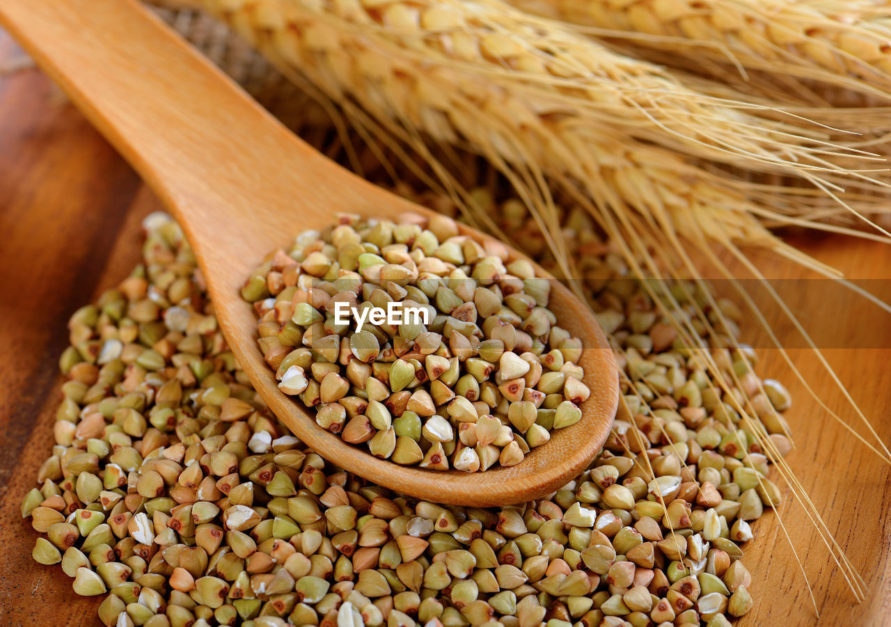food, food and drink, spoon, still life, freshness, eating utensil, kitchen utensil, close-up, wellbeing, seed, no people, healthy eating, raw food, indoors, wooden spoon, cereal plant, wood - material, plant, table, agriculture, vegetarian food, legume family, sweetcorn