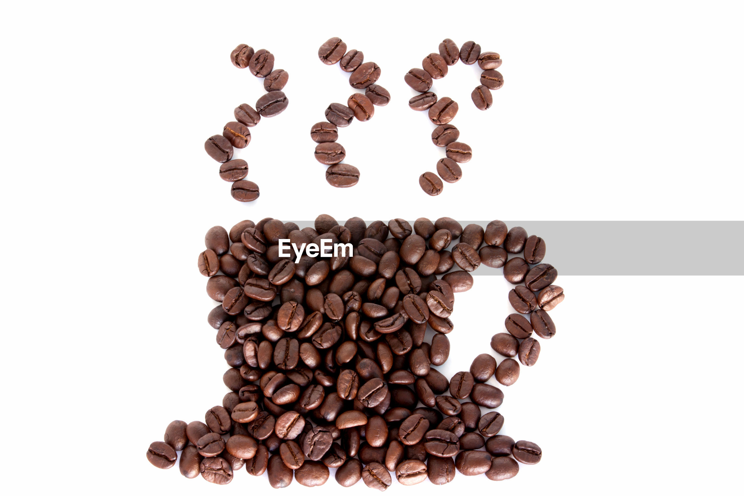 High angle view of cup made with coffee beans against white background