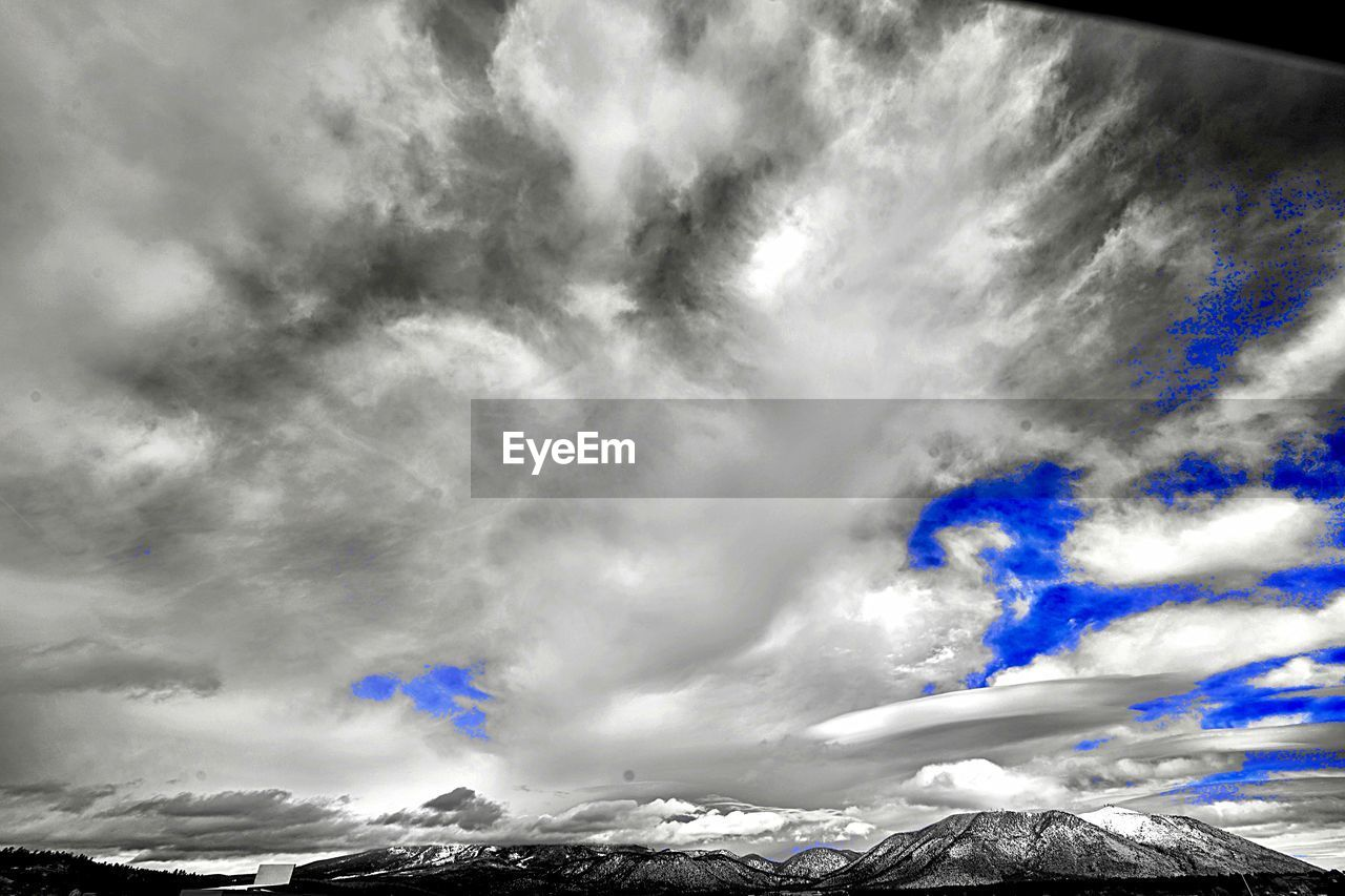 cloud - sky, mountain, sky, scenics - nature, beauty in nature, snow, cold temperature, winter, low angle view, day, non-urban scene, snowcapped mountain, no people, tranquil scene, nature, mountain range, tranquility, environment, outdoors, mountain peak, power in nature