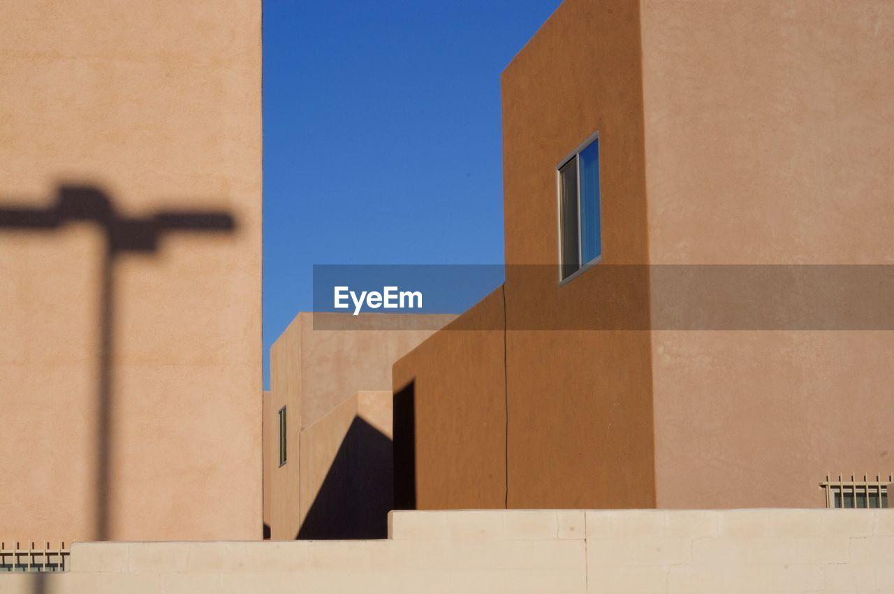 Brown Buildings Against Blue Sky