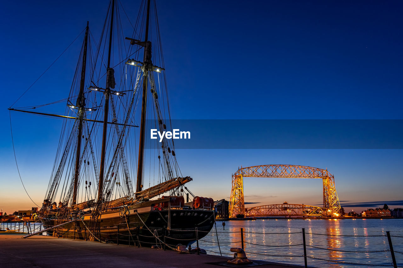 nautical vessel, sky, transportation, mode of transportation, water, sailboat, mast, no people, clear sky, pole, nature, blue, ship, sea, travel, architecture, outdoors, moored, sailing