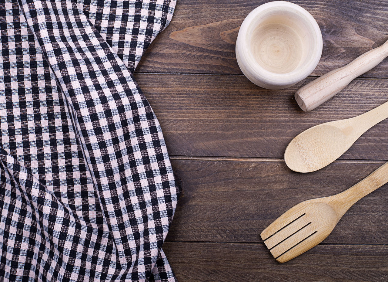 Directly Above Shot Of Wooden Utensils And Napkin On Table