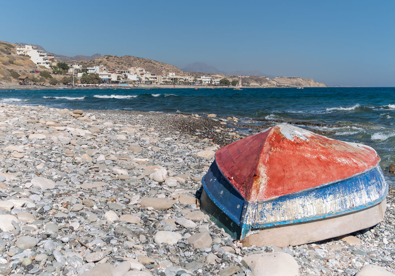 water, sea, beach, land, sky, nature, clear sky, day, blue, scenics - nature, rock, solid, beauty in nature, sand, no people, horizon, horizon over water, rock - object, nautical vessel, outdoors