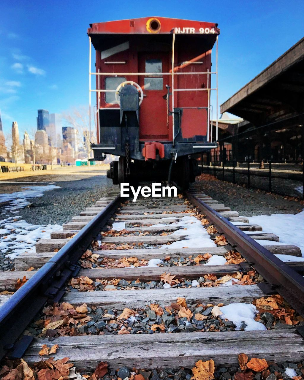 railroad track, rail transportation, built structure, architecture, winter, transportation, outdoors, snow, building exterior, day, cold temperature, sky, real people, one person, nature, people