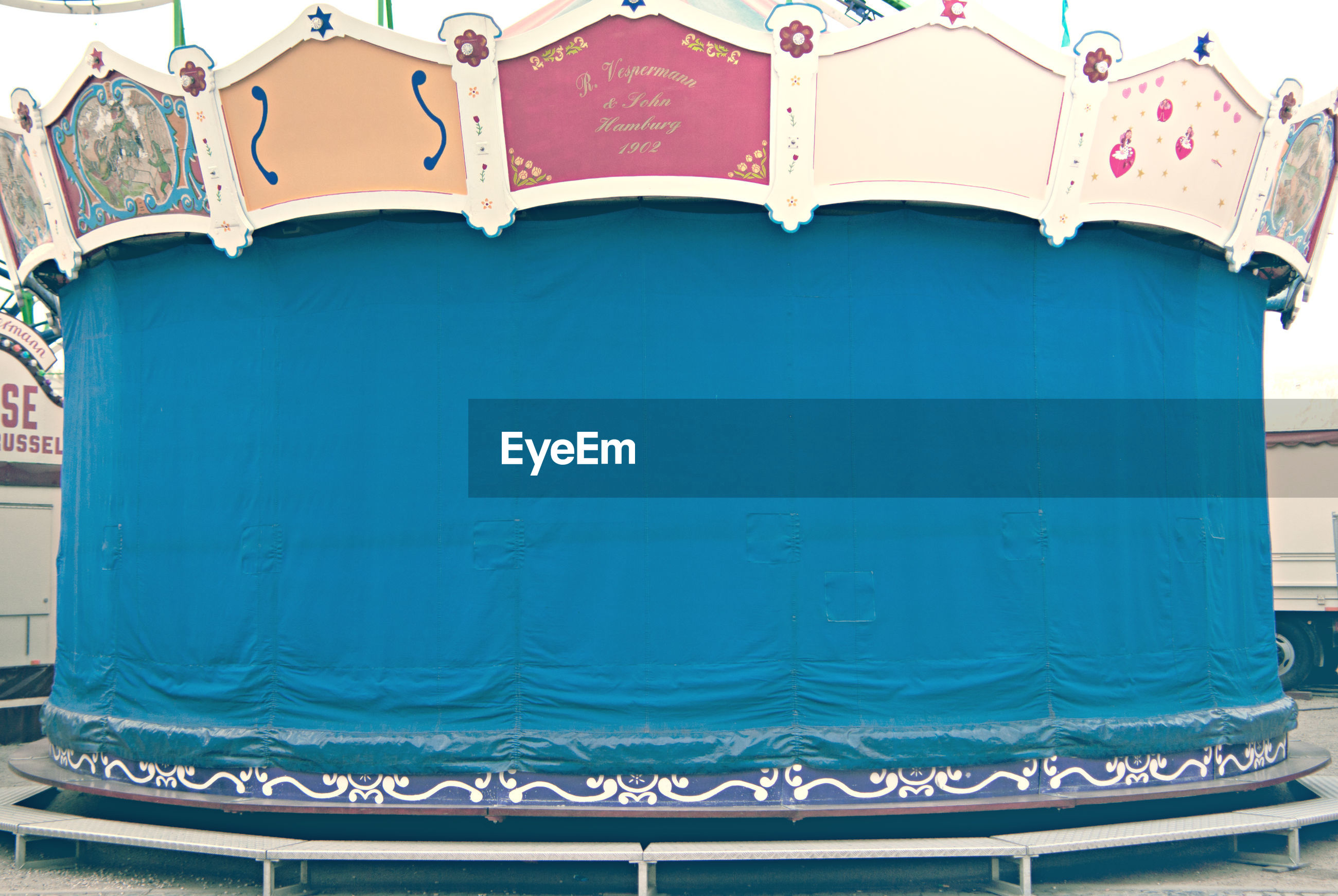 Ride covered with blue tarpaulin at amusement park