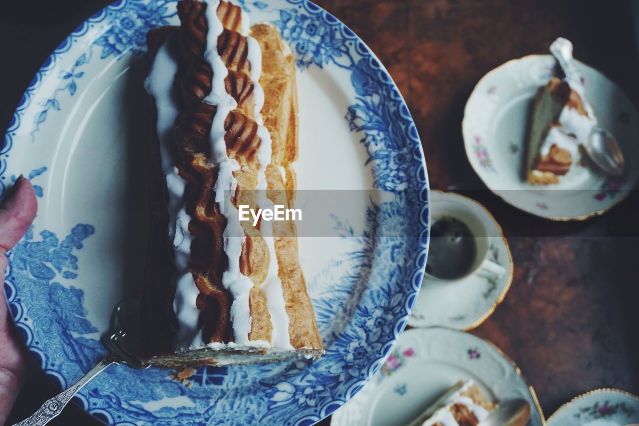 High Angle View Of Cake In Plate At Table
