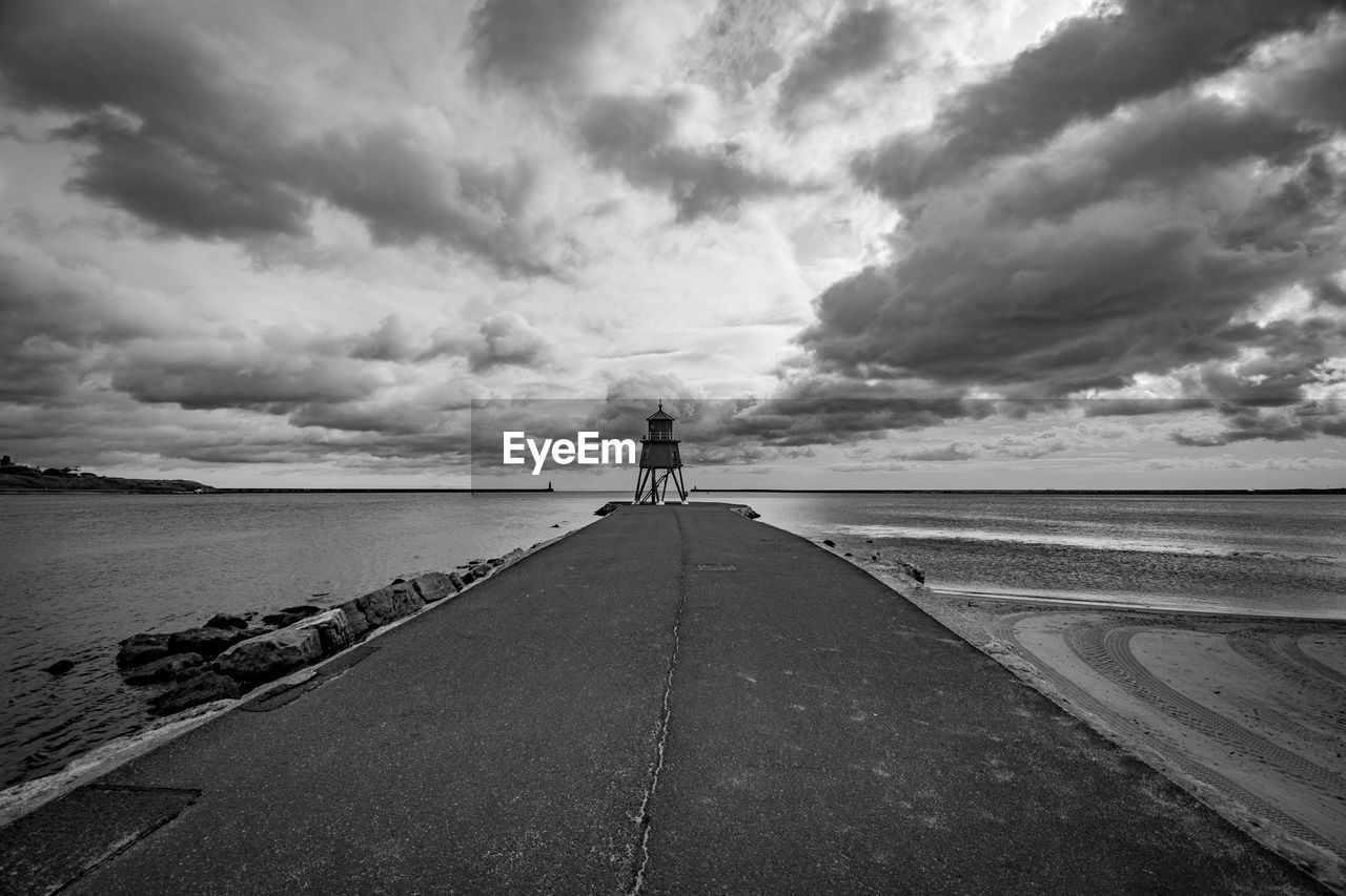 cloud - sky, sky, sea, water, real people, beauty in nature, beach, full length, one person, scenics - nature, nature, rear view, horizon, lifestyles, direction, the way forward, land, horizon over water, diminishing perspective, outdoors