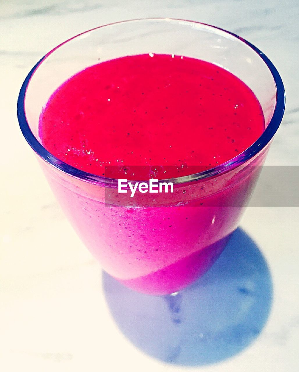drink, drinking glass, refreshment, food and drink, freshness, smoothie, table, blended drink, red, close-up, healthy eating, no people, drinking straw, pink color, cocktail, indoors, cold temperature, day