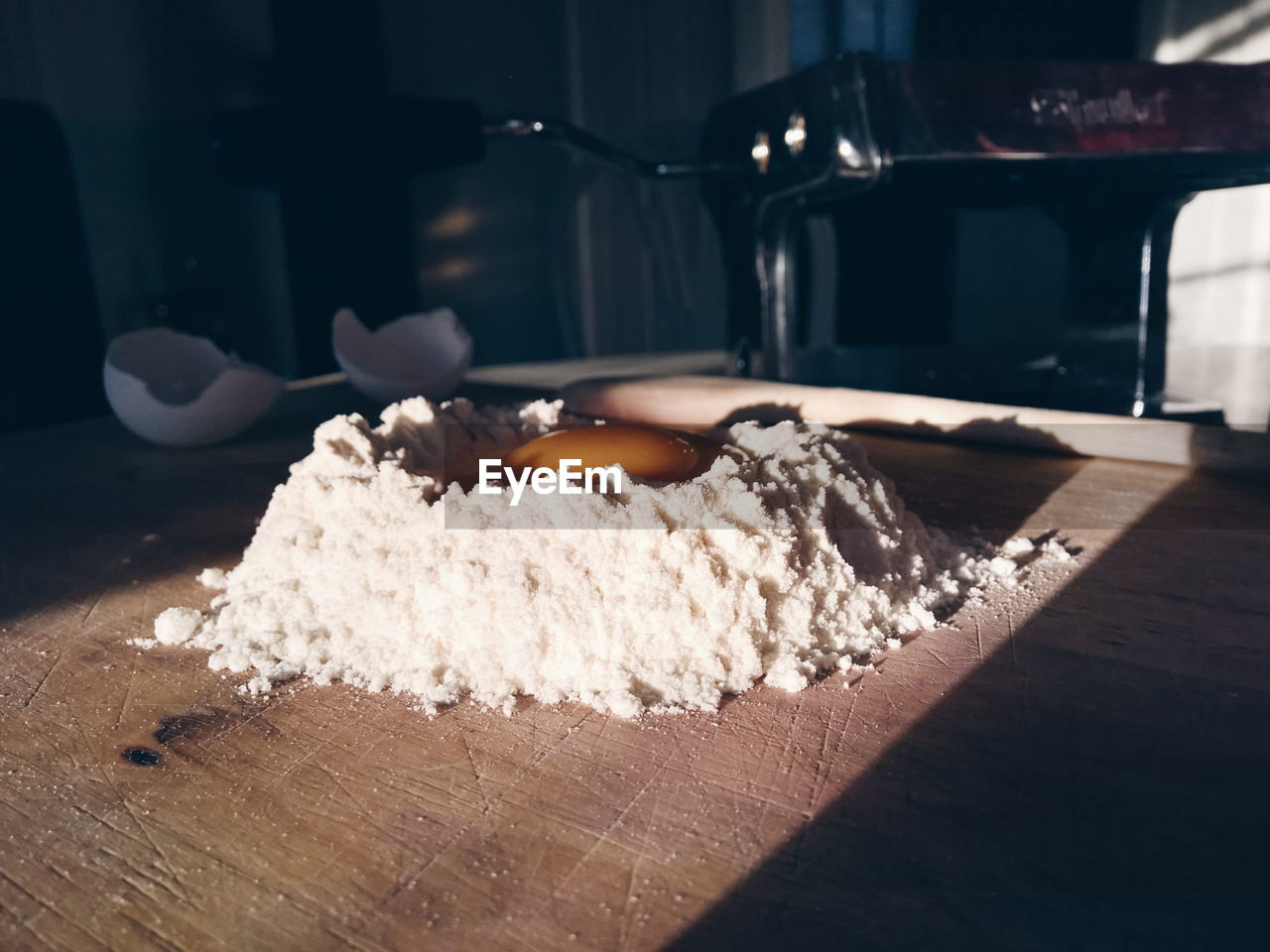 Close-Up Of Egg In Flour On Table