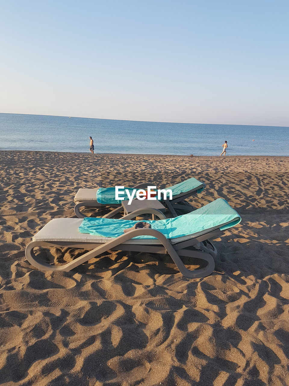 beach, horizon over water, sea, sand, water, shore, tranquility, scenics, nature, tranquil scene, clear sky, sun lounger, beauty in nature, sky, sunlight, day, no people, vacations, outdoors, summer