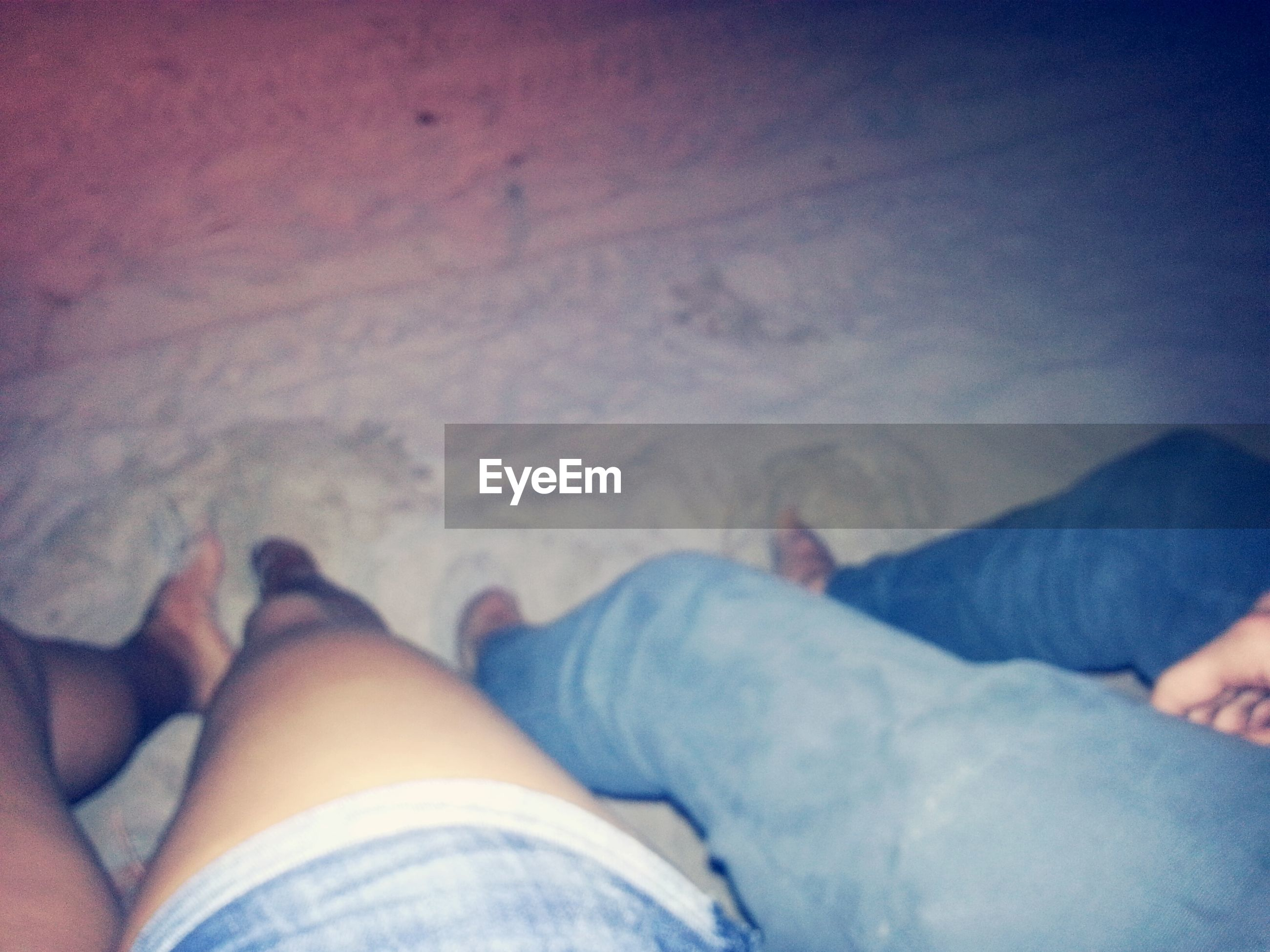 low section, person, lifestyles, leisure activity, relaxation, personal perspective, barefoot, togetherness, human foot, beach, sand, lying down, resting, sitting, vacations