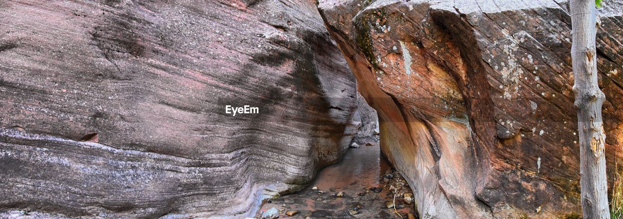 rock formation, rock, textured, no people, rock - object, geology, pattern, natural pattern, solid, rough, close-up, nature, day, beauty in nature, physical geography, outdoors, low angle view, tranquility, brown, non-urban scene, eroded