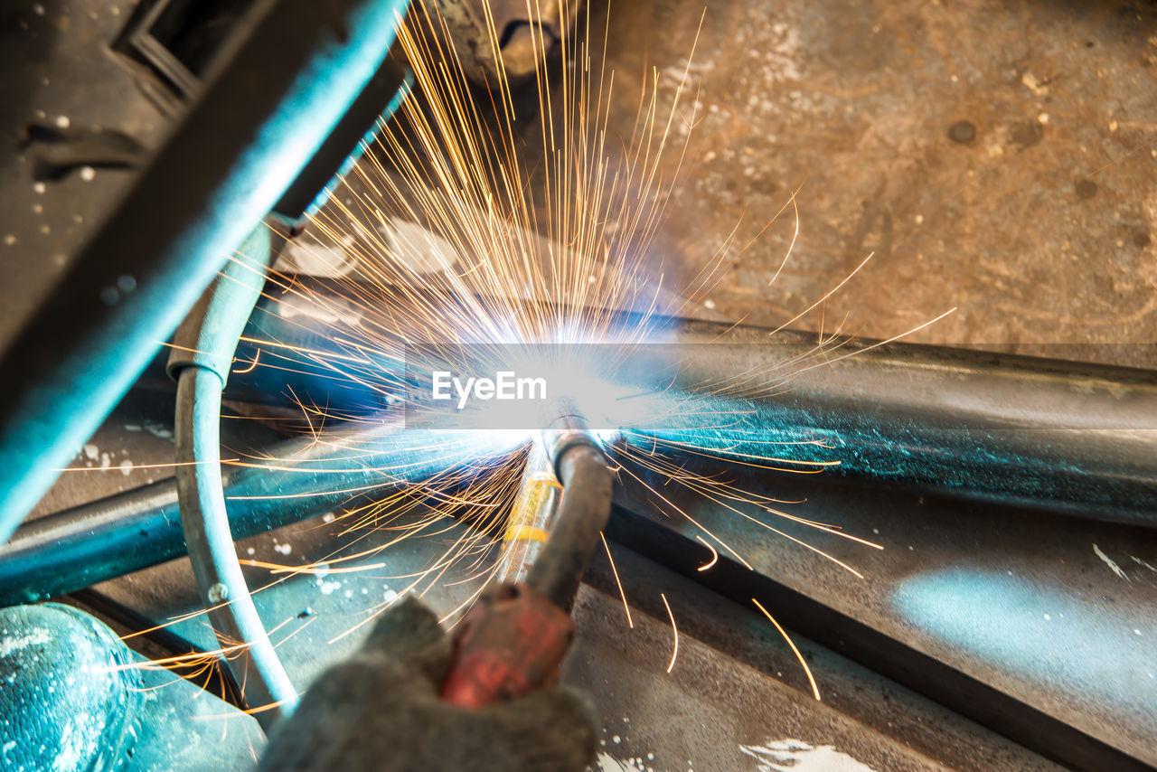 Close-up of man welding metal