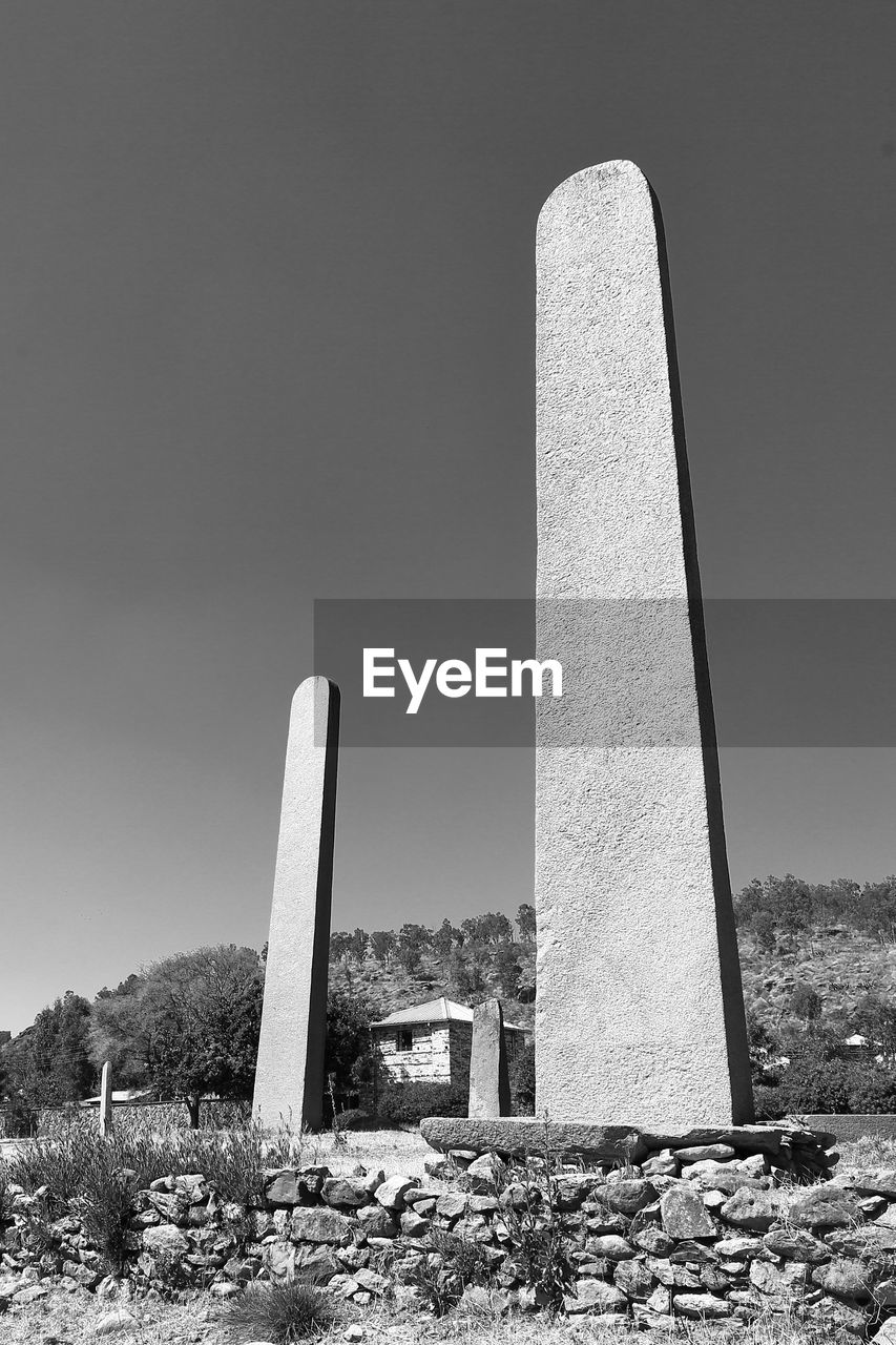 rock - object, ancient, built structure, history, memorial, monument, no people, architecture, day, architectural column, clear sky, outdoors, ancient civilization, nature, sky