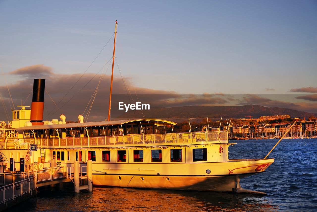 nautical vessel, transportation, mode of transport, sky, boat, water, sea, outdoors, no people, moored, nature, beauty in nature, day, scenics, sunset, architecture