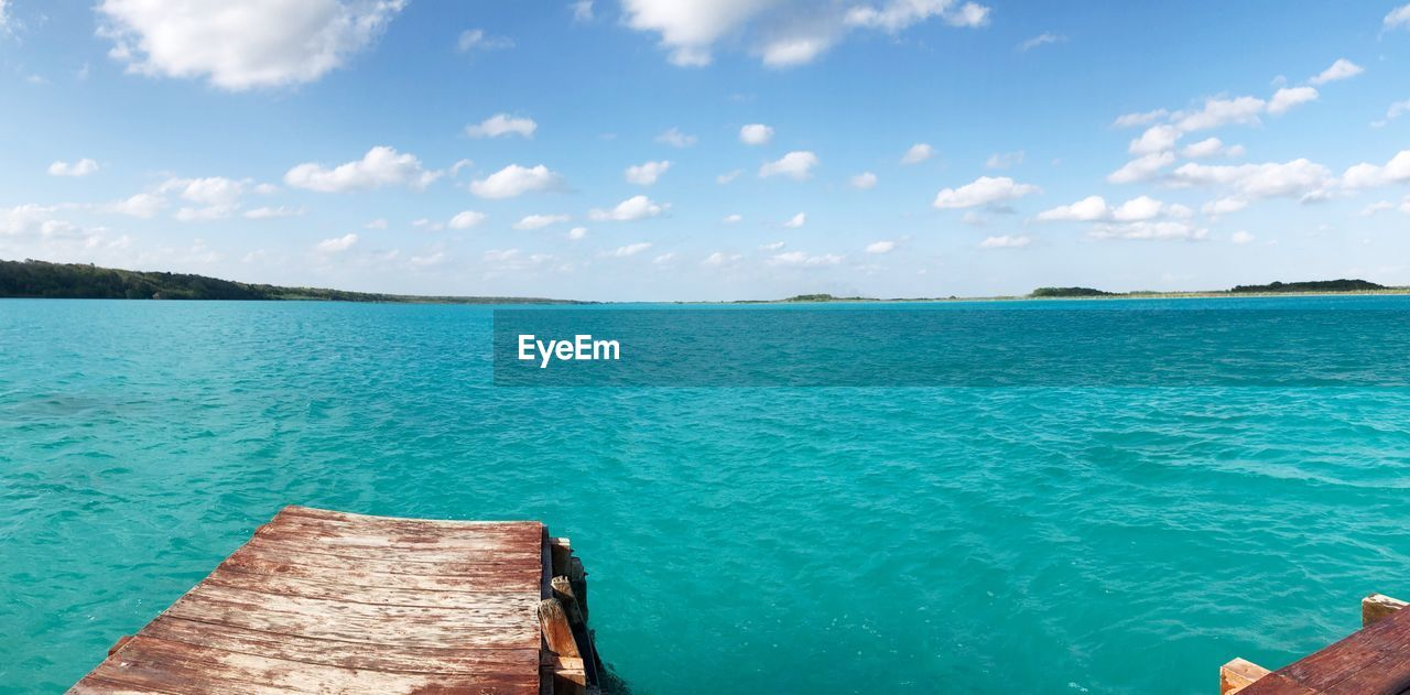 water, sky, sea, scenics - nature, cloud - sky, beauty in nature, tranquility, nature, day, tranquil scene, blue, idyllic, turquoise colored, no people, outdoors, land, wood - material, transportation, travel