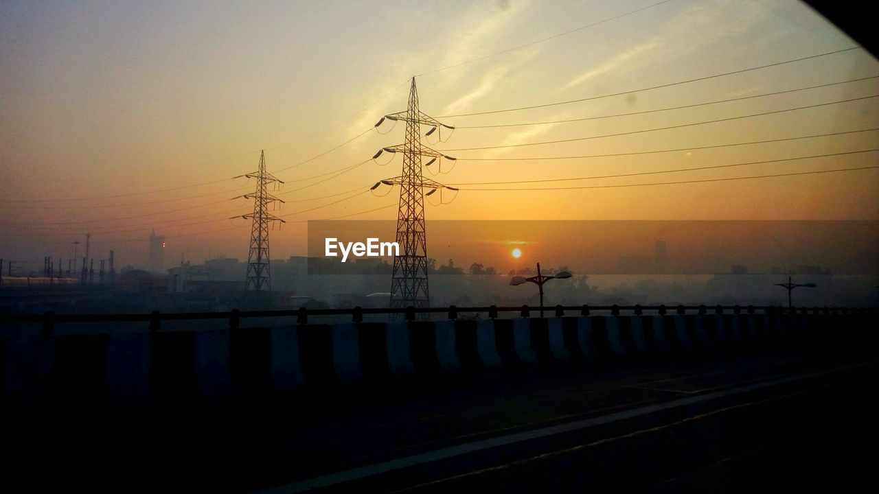 sunset, silhouette, connection, sky, no people, sun, electricity pylon, outdoors, nature, technology, beauty in nature, day