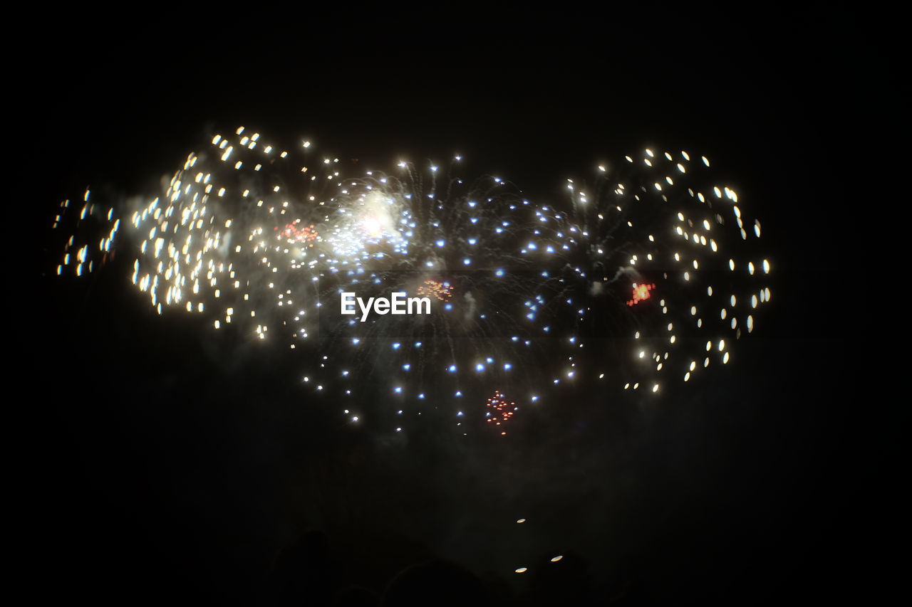 firework display, night, celebration, firework - man made object, exploding, long exposure, sparks, arts culture and entertainment, event, glowing, illuminated, blurred motion, motion, firework, smoke - physical structure, low angle view, outdoors, multi colored, no people, sparkler, sky, diwali