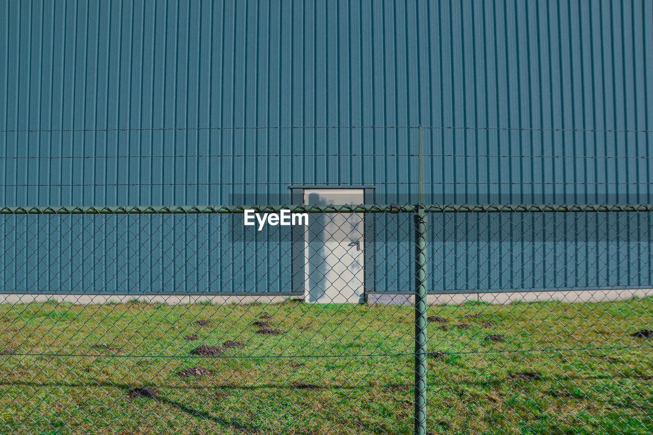 Fence Against Corrugated Iron