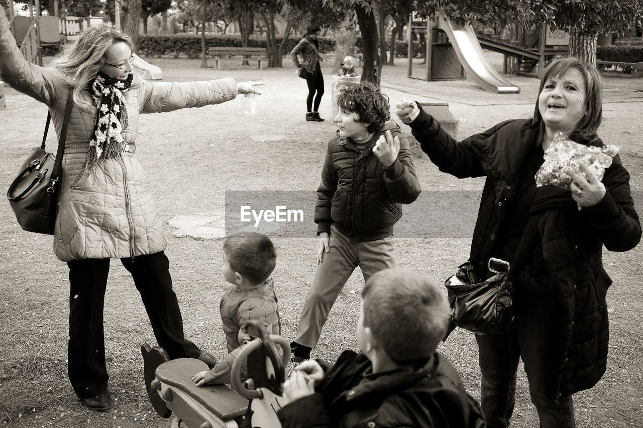 Mothers With Playful Children At Park
