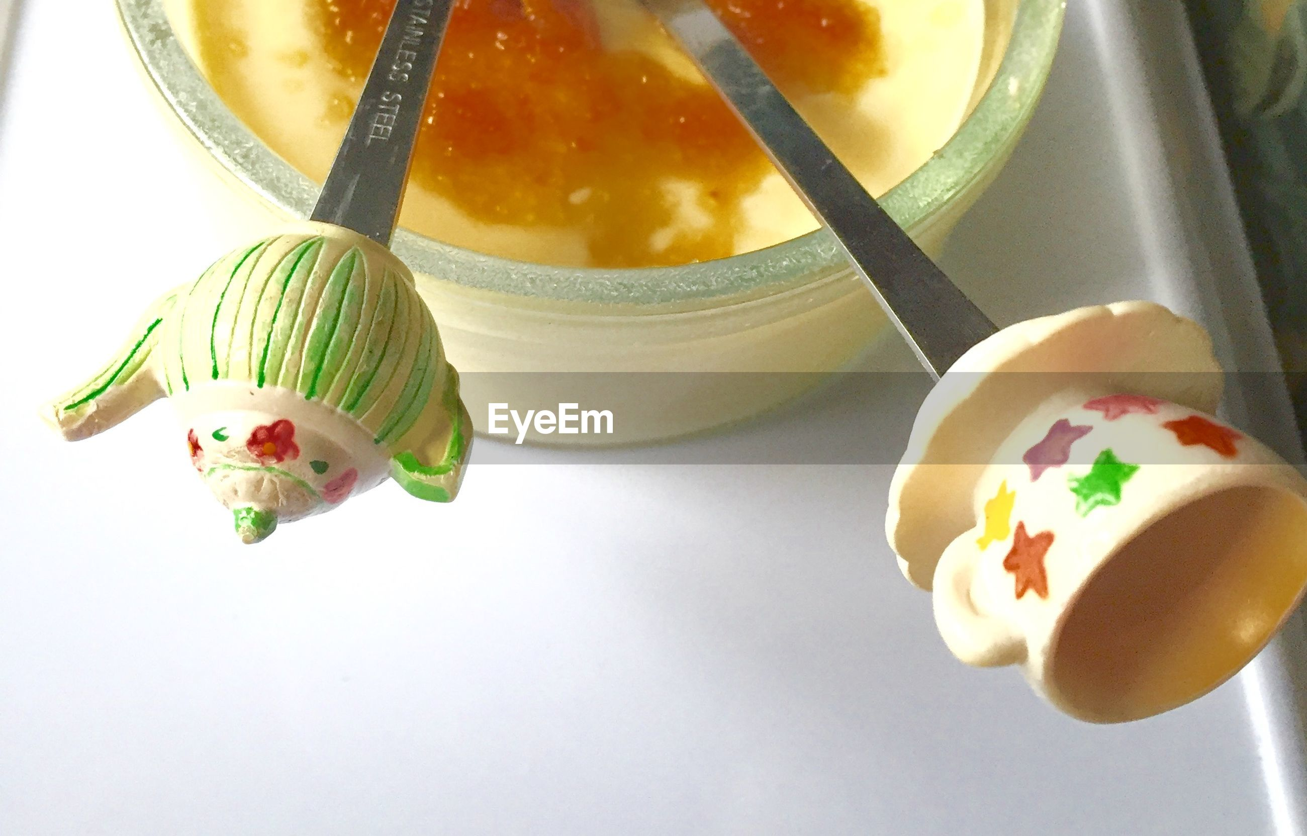 Close-up of creme brulee with decorated spoons