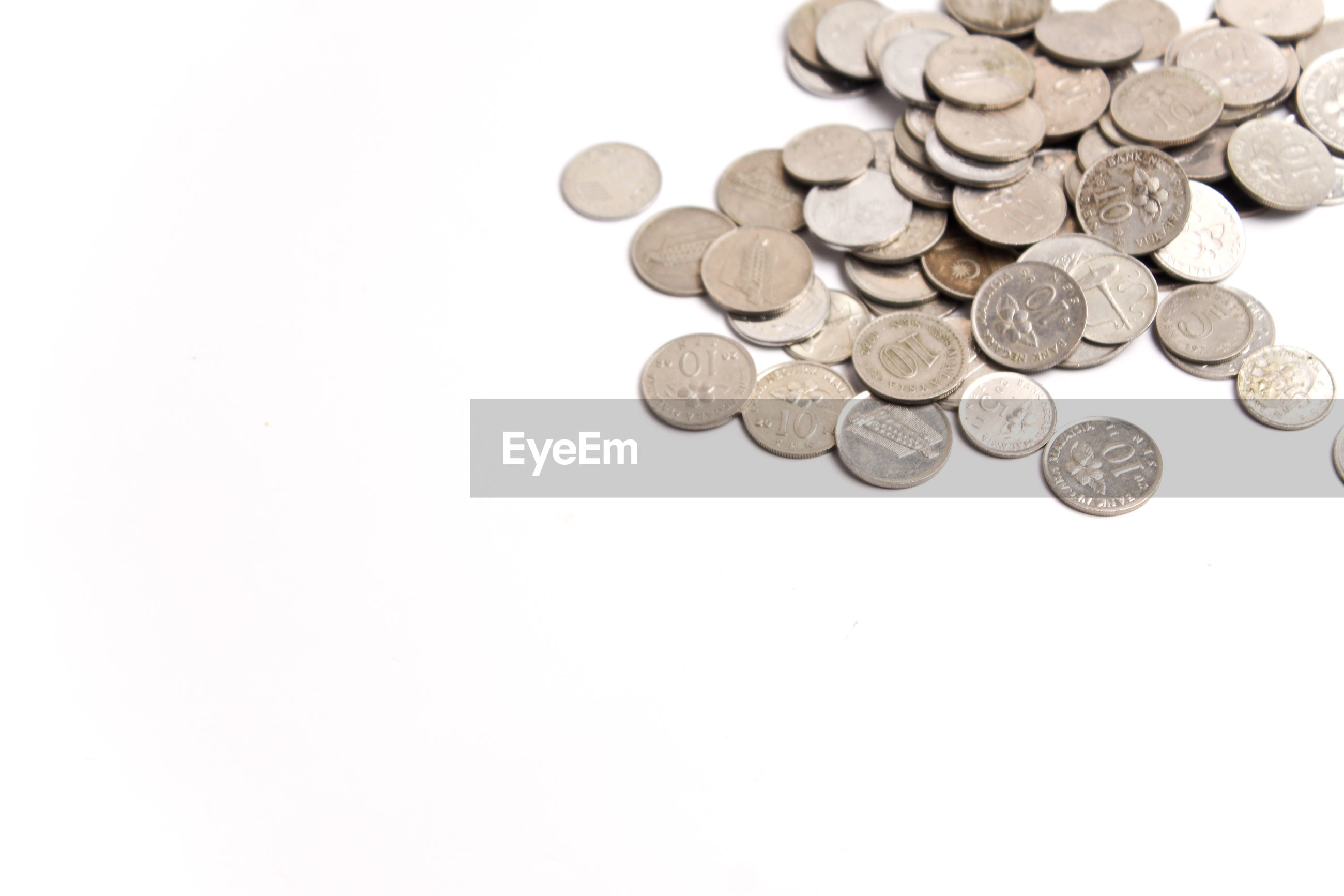 High angle view of malaysian coins on white background