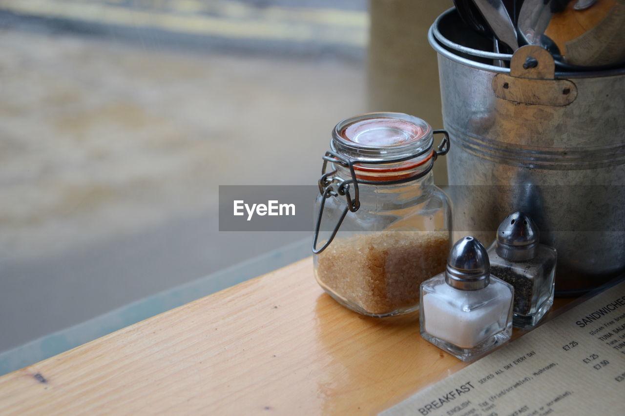 High angle view of jars on table