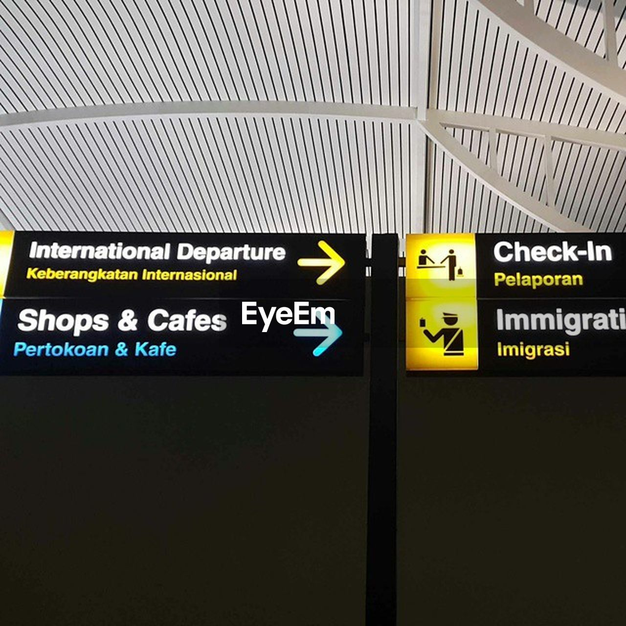 guidance, communication, text, direction, yellow, transportation, airport, indoors, illuminated, no people, day