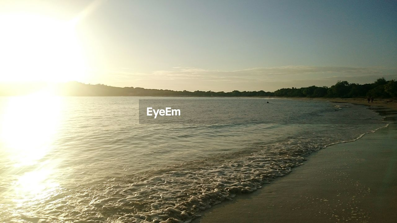 water, sea, nature, sunlight, sunset, sun, scenics, beauty in nature, beach, tranquil scene, tranquility, outdoors, no people, holiday, sky, sand, day, tree