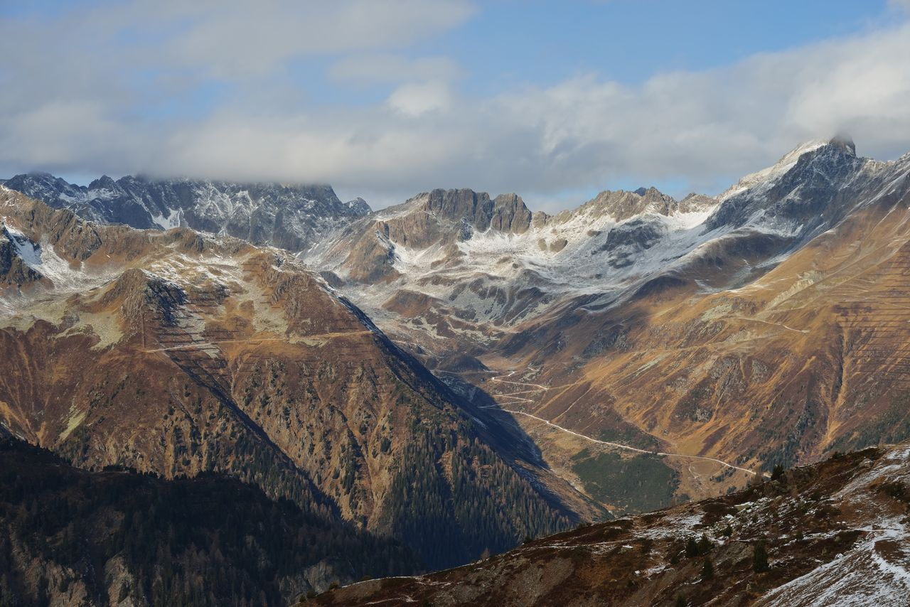 mountain, mountain range, scenics - nature, beauty in nature, sky, environment, tranquil scene, cloud - sky, landscape, tranquility, non-urban scene, no people, day, nature, idyllic, physical geography, remote, rock, winter, cold temperature, formation, mountain peak, outdoors, snowcapped mountain, range