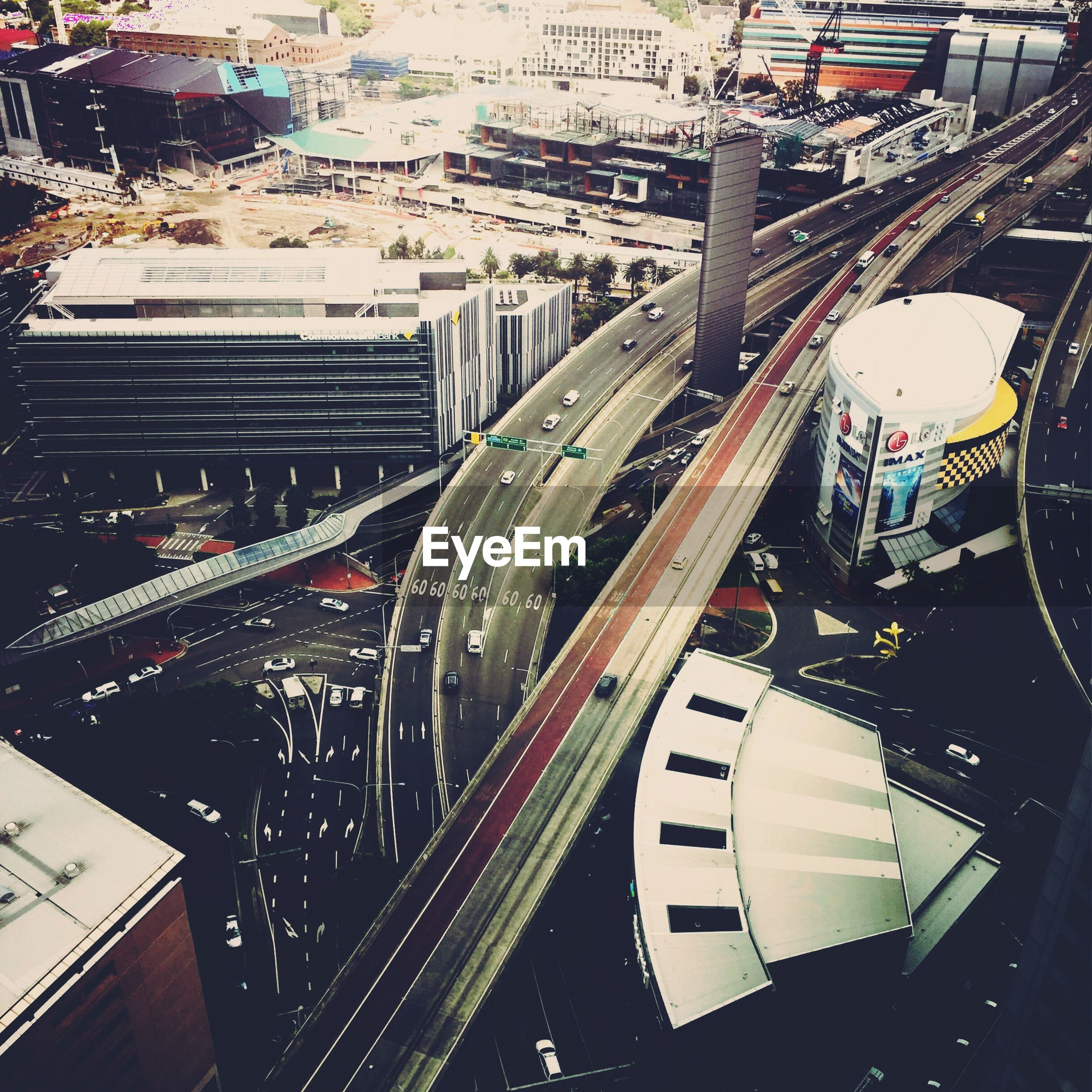 Tilt shift image of elevated roads amidst buildings in city