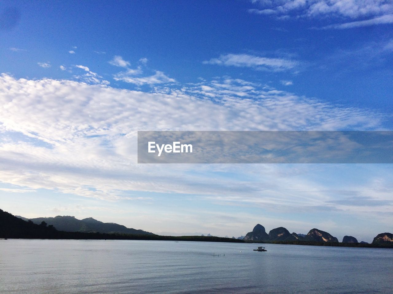 sky, cloud - sky, water, scenics - nature, tranquility, beauty in nature, tranquil scene, sea, nature, waterfront, mountain, no people, blue, day, outdoors, architecture, idyllic, transportation, remote