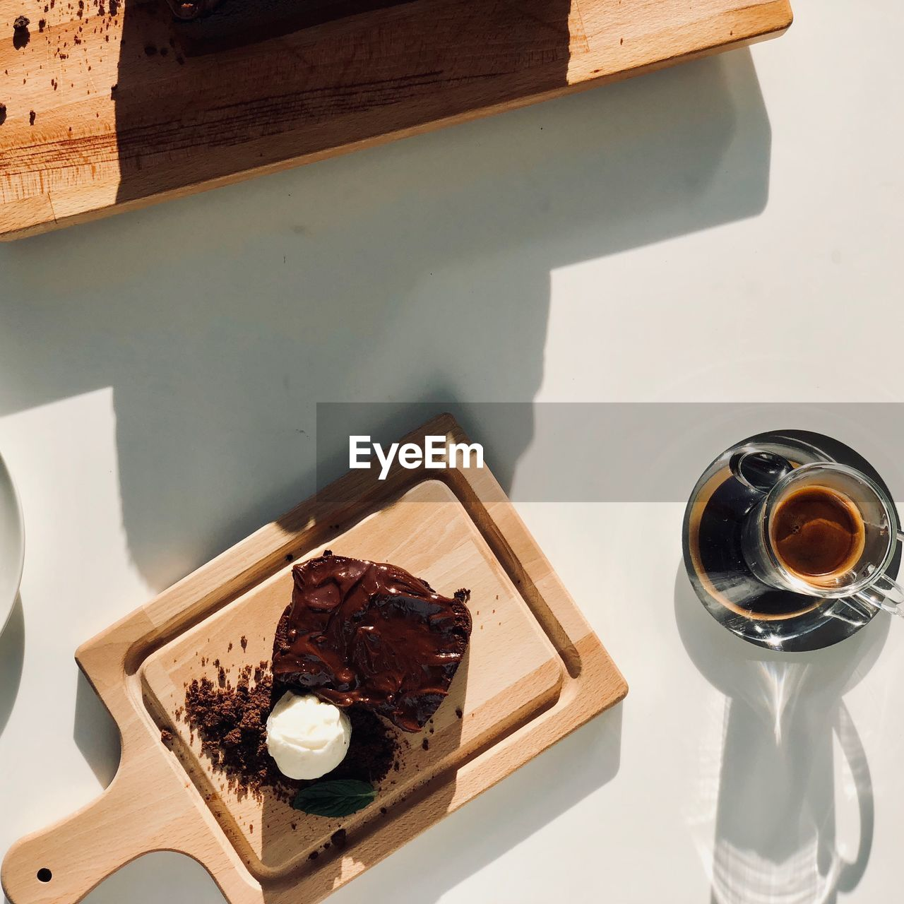 High angle view of cake with coffee on table