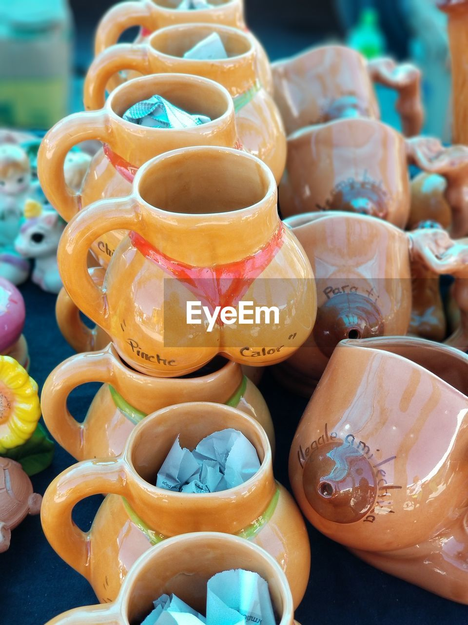 multi colored, close-up, still life, focus on foreground, large group of objects, choice, no people, art and craft, variation, for sale, abundance, container, retail, arrangement, day, in a row, cup, collection, indoors, food and drink