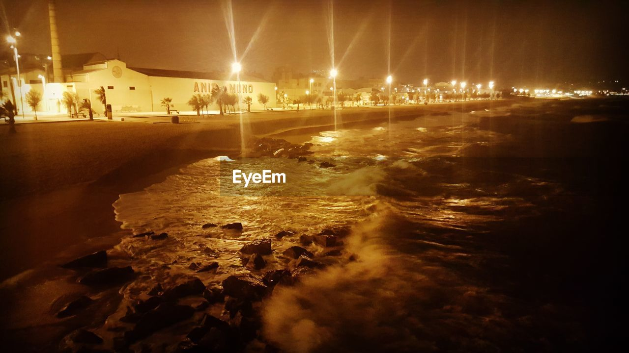 night, illuminated, water, motion, sea, outdoors, nature, wave, city, no people, architecture, power in nature, sky