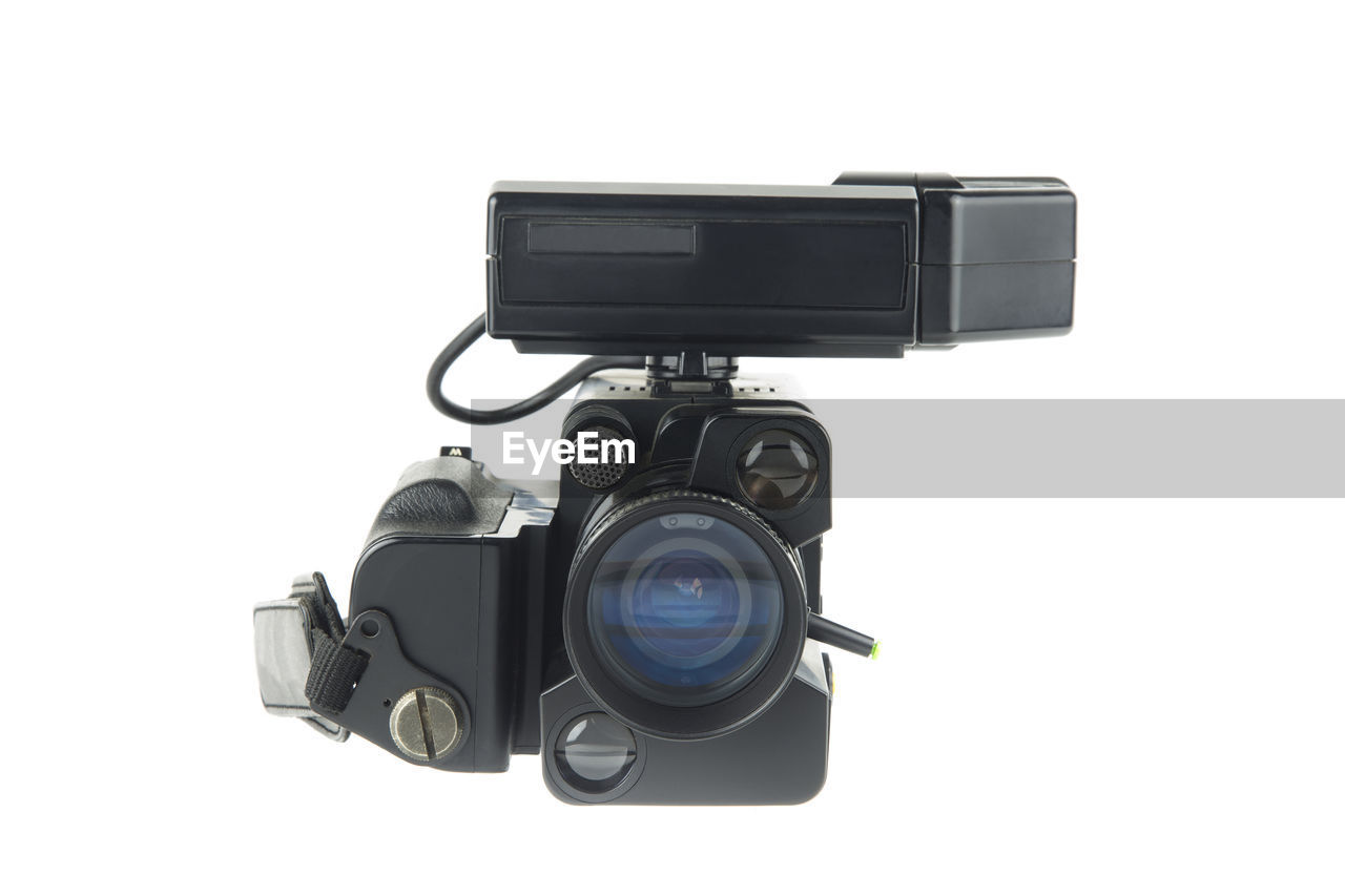 Close-up of home video camera against white background