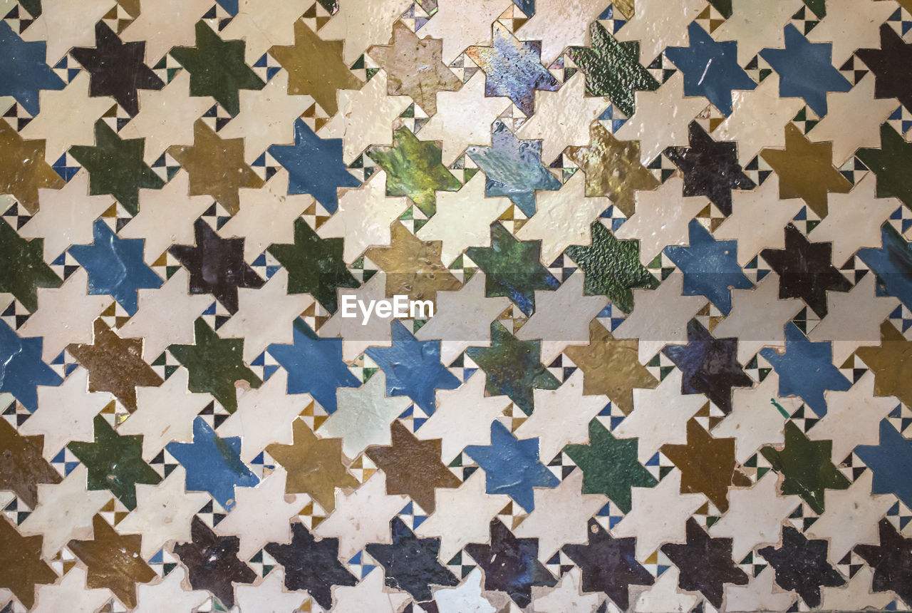 full frame, no people, backgrounds, pattern, indoors, close-up, puzzle, large group of objects, design, jigsaw piece, abundance, textured, connection, shape, still life, multi colored, repetition, jigsaw puzzle, wall - building feature, star shape