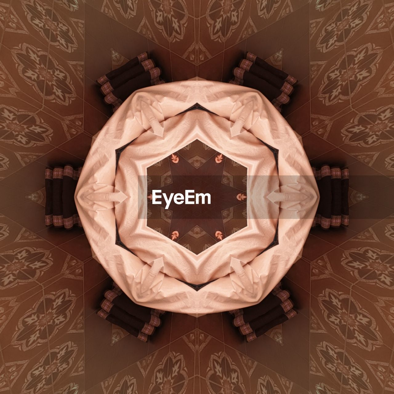 pattern, indoors, no people, design, floral pattern, close-up, creativity, shape, wall - building feature, art and craft, symmetry, table, wood - material, directly above, decoration, star shape, still life, carving - craft product, representation, metal, digital composite, ornate