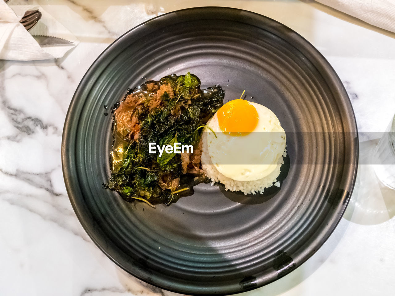 food, food and drink, egg, freshness, ready-to-eat, healthy eating, indoors, still life, fried egg, wellbeing, meal, table, plate, breakfast, serving size, no people, fried, egg yolk, high angle view, directly above, sunny side up, temptation