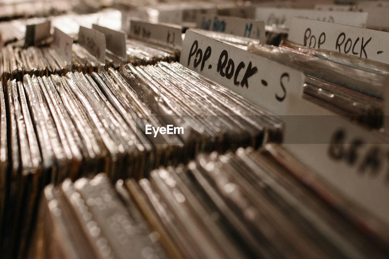 Full frame shot of packed vinyl records for sale in market