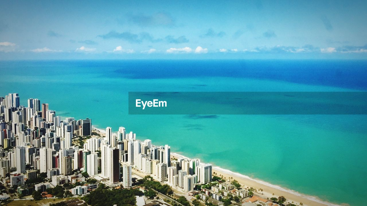 High Angle View Of Sea And City