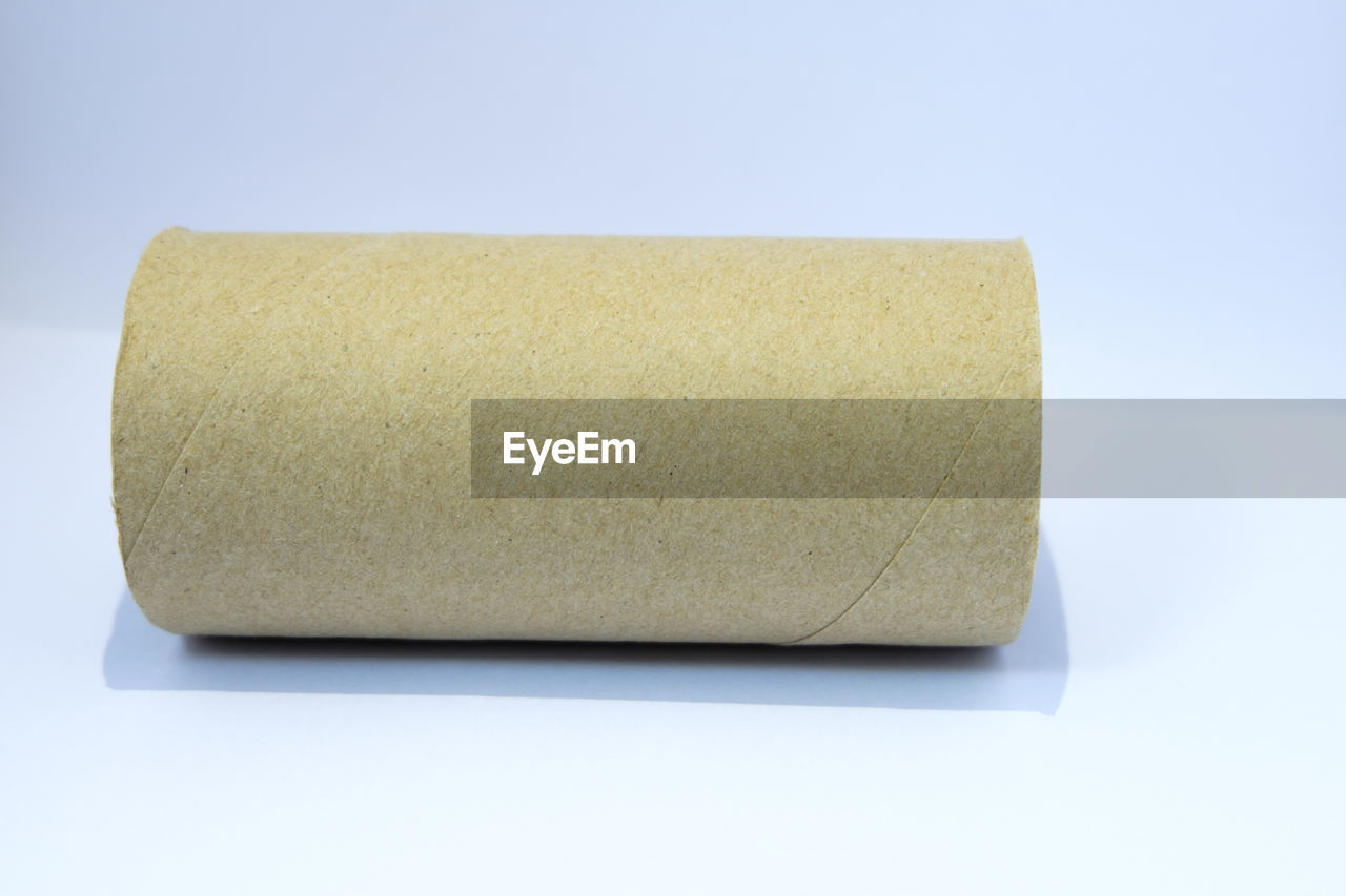 Close-up of rolled cardboard on white background