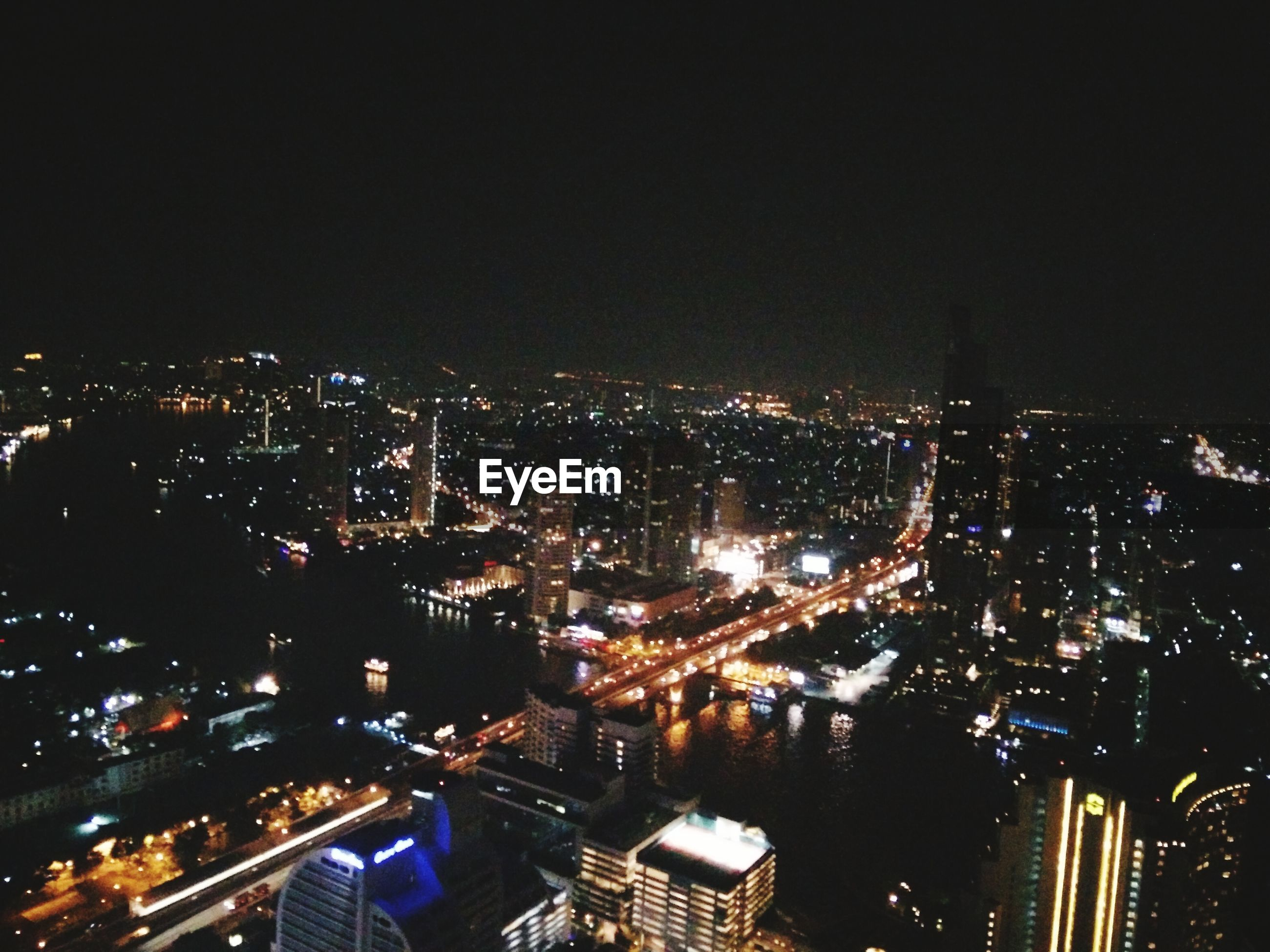 cityscape, illuminated, city, night, building exterior, architecture, crowded, built structure, high angle view, skyscraper, residential district, city life, residential building, aerial view, modern, office building, residential structure, tower, sky, copy space