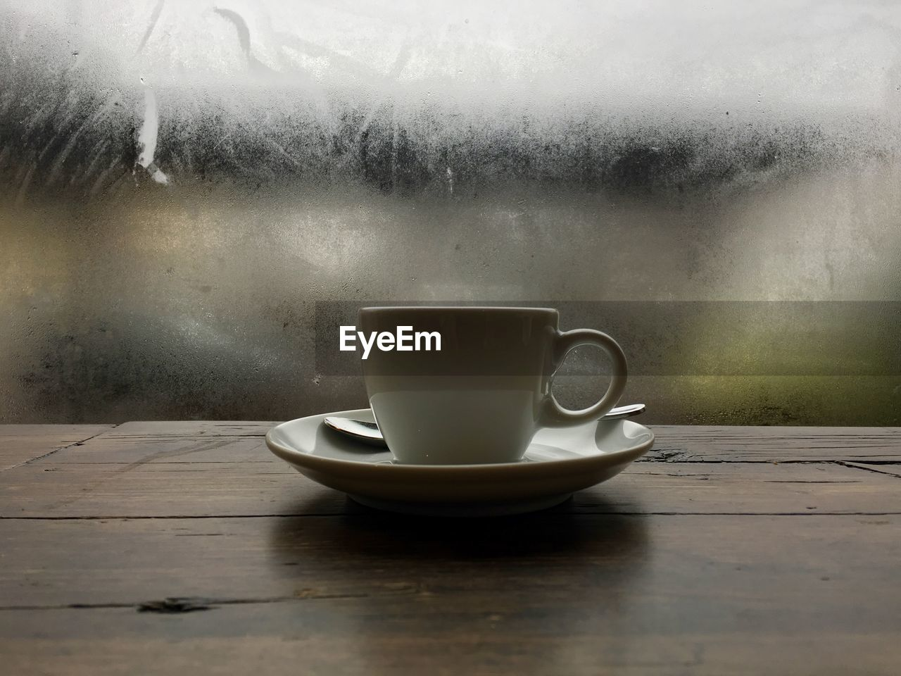 coffee cup, coffee - drink, drink, food and drink, refreshment, cup, table, saucer, indoors, freshness, wood - material, close-up, no people, steam, frothy drink, day, water